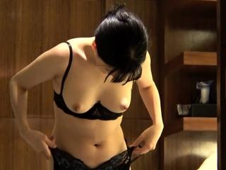 Asian masturbated close to two toys